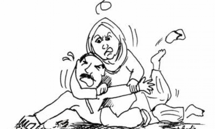 Një grua rrah një burrë